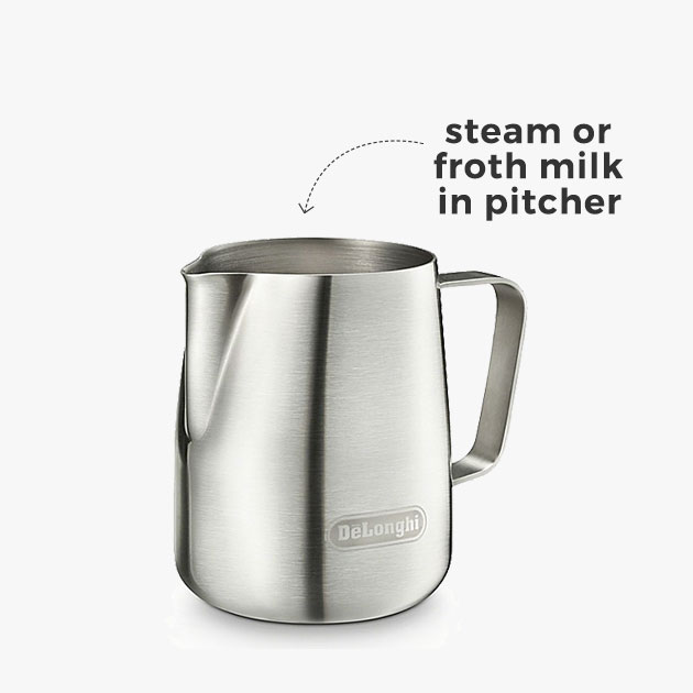 steam or froth milk in pitcher