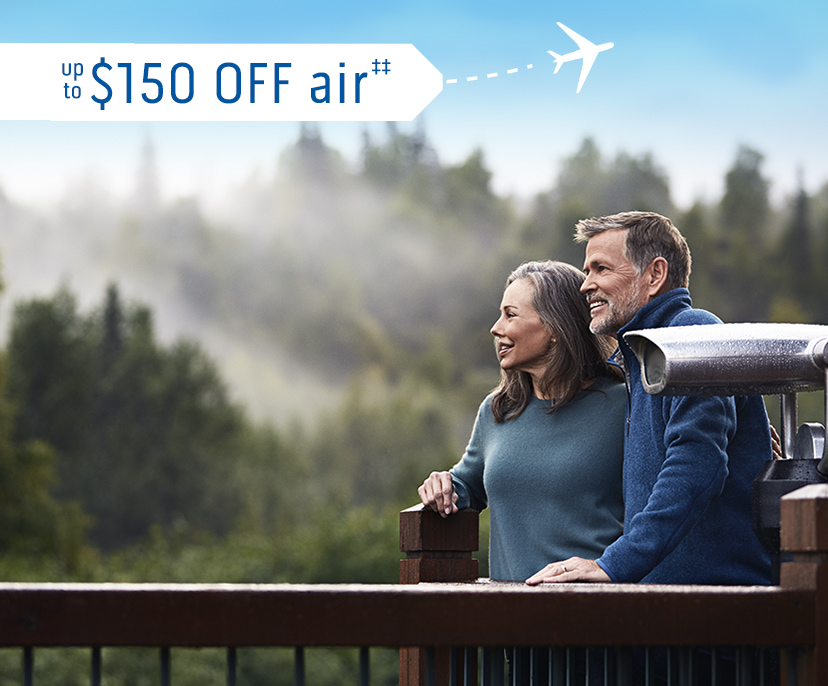 Image of a happy couple looking at the mist on the tree tops - up to $150 OFF air‡‡ | Click here to book now