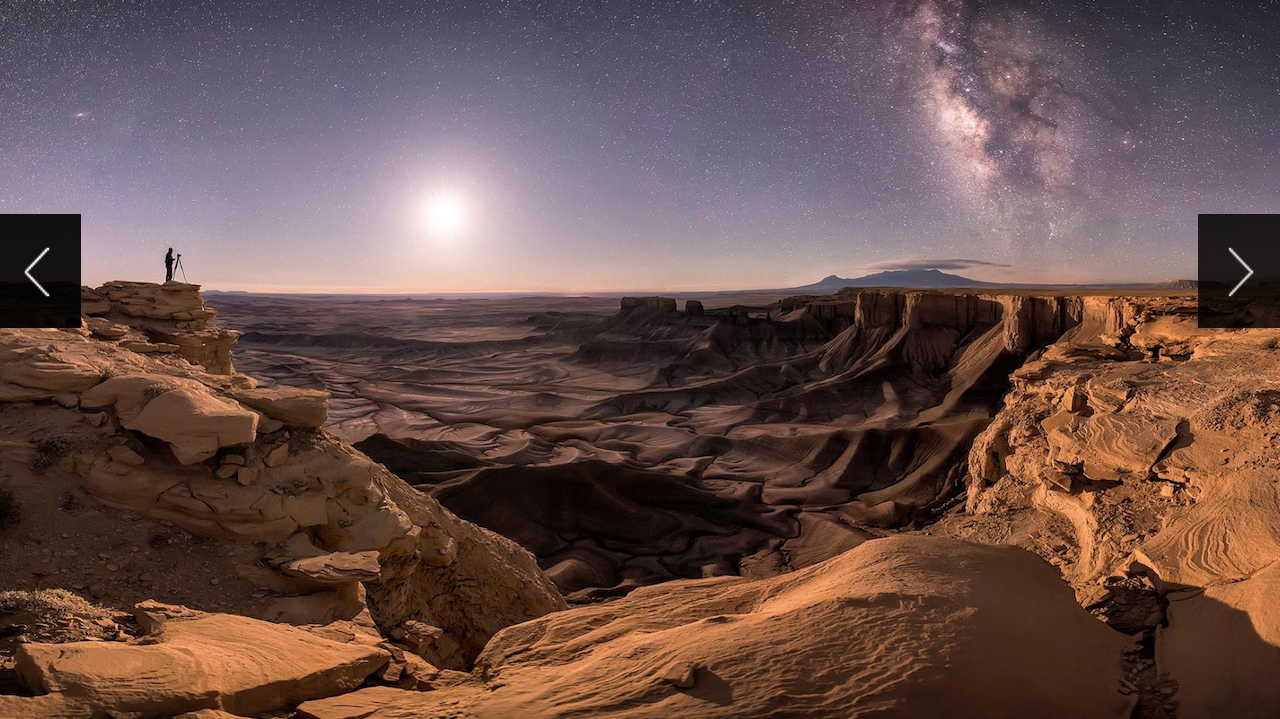 Photographer in Moab, Utah, under night sky containing Andromeda Galaxy, Milky Way, and moon